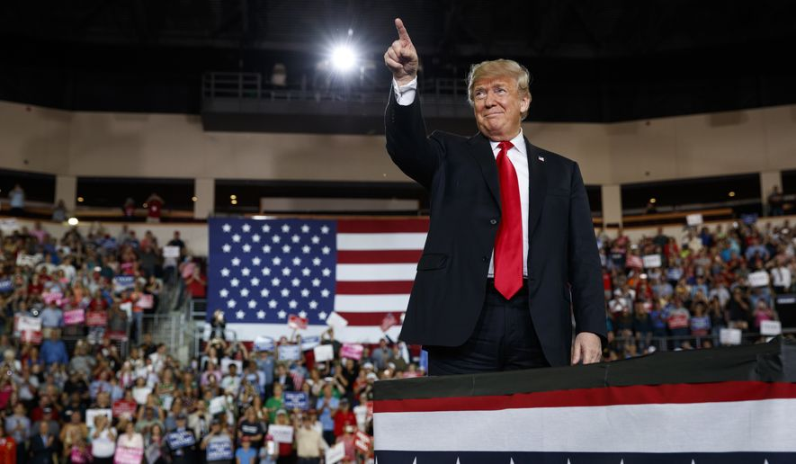 President Donald Trump arrives to speak at a campaign rally at Erie Insurance Arena, Wednesday, Oct. 10, 2018, in Erie, Pa. As Hurricane Michael pounded the Southeast on Wednesday, Trump took shelter at the campaign rally in Pennsylvania, where he sought to boost Republicans before the midterms. (AP Photo/Evan Vucci)