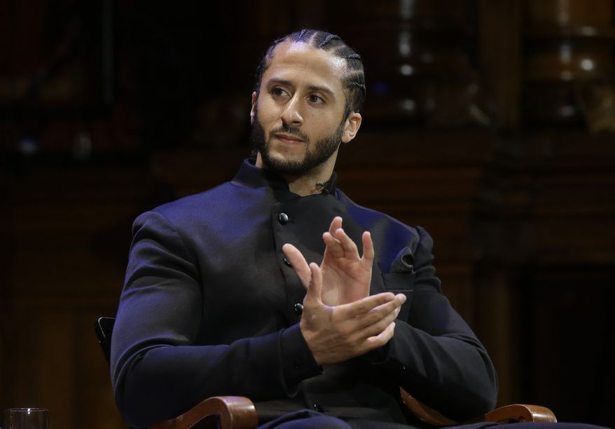 Former NFL football quarterback Colin Kaepernick applauds while seated on stage during W.E.B. Du Bois Medal ceremonies, Thursday, Oct. 11, 2018, at Harvard University, in Cambridge, Mass. Kaepernick is among eight recipients of Harvard University's W.E.B. Du Bois Medals in 2018. Harvard has awarded the medal since 2000 to people whose work has contributed to African and African-American culture.(AP Photo/Steven Senne)