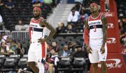 Washington Wizards guard John Wall (2) and guard Bradley Beal (3) stand on the court during the first half of an NBA preseason basketball game against the New York Knicks, Monday, Oct. 1, 2018, in Washington. (AP Photo/Nick Wass)
