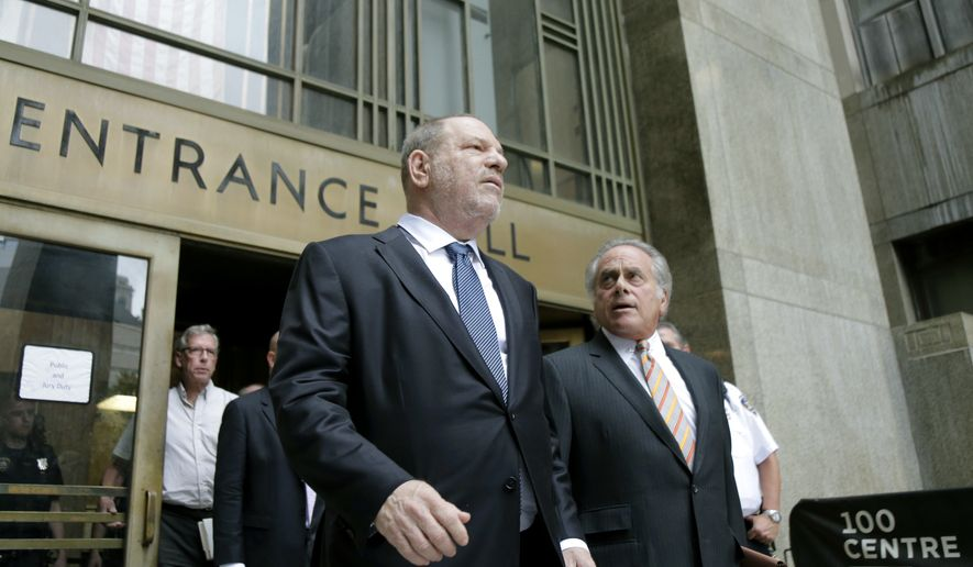 Harvey Weinstein, left, leaves court with his attorney Benjamin Brafman in New York, Thursday, Oct. 11, 2018. Manhattan's district attorney dropped part of the criminal sexual assault case against Weinstein on Thursday after evidence emerged that cast doubt on the account one of his three accusers provided to the grand jury. (AP Photo/Seth Wenig)