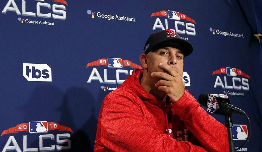 Boston Red Sox manager Alex Cora listens to a question during a news conference at a baseball workout, Thursday, Oct. 11, 2018, in Boston. The Red Sox face the Houston Astros in Game 1 of baseball's American League Championship Series on Saturday at Fenway Park in Boston. (AP Photo/Elise Amendola)