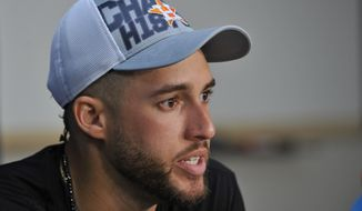 Houston Astros' George Springer speaks at a news conference after the Astros defeated the Cleveland Indians in Game 3 of a baseball American League Division Series, Monday, Oct. 8, 2018, in Cleveland. (AP Photo/Phil Long)