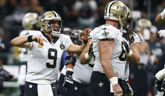 New Orleans Saints quarterback Drew Brees (9) celebrates after he broke the NFL all-time passing yards record in the first half of an NFL football game against the Washington Redskins in New Orleans, Monday, Oct. 8, 2018. (AP Photo/Butch Dill)