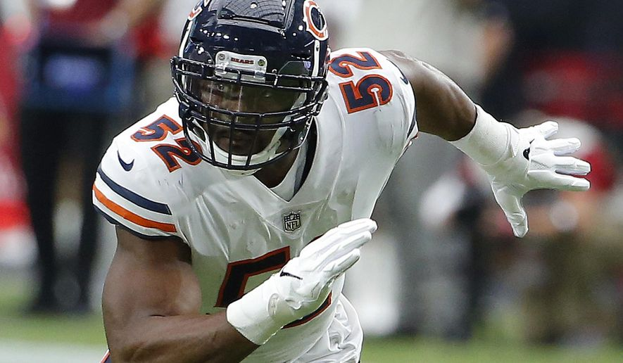 FILE - In this Sept. 23, 2018, file photo, Chicago Bears linebacker Khalil Mack (52) is shown in action in the first half during an NFL football game against the Arizona Cardinals, in Glendale, Ariz. Last week the Miami Dolphins tried assigning eight players to help with pass protection, and even that didn't prevent Ryan Tannehill from getting hit.And now the Dolphins have to block Khalil Mack. (AP Photo/Rick Scuteri, File)