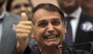 Presidential candidate Jair Bolsonaro, of the right wing Social Liberal Party speaks during a press conference in Rio de Janeiro, Brazil, Thursday, Oct. 11, 2018. Bolsonaro will face Workers Party presidential candidate Fernando Haddad in a presidential runoff on Oct. 28. (AP Photo/Leo Correa)