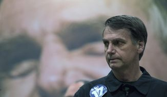 Presidential candidate Jair Bolsonaro, of the right wing Social Liberal Party arrives for a press conference in Rio de Janeiro, Brazil, Thursday, Oct. 11, 2018. Bolsonaro will face Workers Party presidential candidate Fernando Haddad in a presidential runoff on Oct. 28. (AP Photo/Leo Correa)