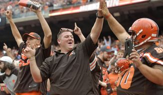 FILE - In this Oct. 7, 2018, file photo, Cleveland Browns fans celebrate after the Browns defeated the Baltimore Ravens 12-9 during overtime in an NFL football game, in Cleveland. The Los Angeles Chargers play at Cleveland on Sunday. (AP Photo/David Richard, File)