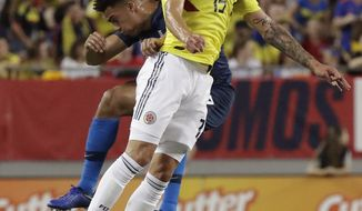 Colombia midfielder Mateus Uribe (15) goes up for a header against United States' Antonee Robinson, left, during the first half of an international friendly soccer match Thursday, Oct. 11, 2018, in Tampa, Fla. (AP Photo/John Raoux)