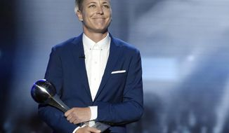FILE - In this July 13, 2016, file photo, former U.S. soccer player Abby Wambach accepts an icon award at the ESPY Awards at the Microsoft Theater in Los Angeles. Wambach is joining COPA90, a multi-platform media company headquartered in London, in advance of women's World Cup soccer tournament in France this summer. The content is featured on Facebook, Twitter, YouTube and other social media platforms. (Photo by Chris Pizzello/Invision/AP, File)