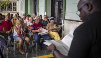 In this Sept. 30, 2018 photo, residents gather for a public forum on constitutional reform in Havana, Cuba. At a half-dozen public forums attended by Associated Press journalists this month, Cubans repeatedly called for direct election of the president and other officials, while many objected to allowing gays and lesbians to marry. (AP Photo/Desmond Boylan)