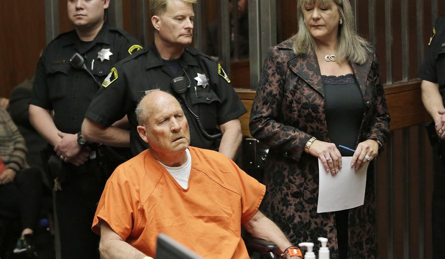 """FILE - In this Friday, April 27, 2018 file photo, Joseph James DeAngelo, 72, who authorities suspect is the """"Golden State Killer"""" responsible for at least a dozen murders and 50 rapes in the 1970s and 80s, is accompanied by Sacramento County Public Defender Diane Howard, right, during his arraignment in Sacramento County Superior Court in Sacramento, Calif. Authorities said they used a genetic genealogy website to connect some crime-scene DNA to DeAngelo. (AP Photo/Rich Pedroncelli)"""