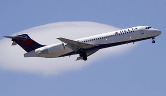 FILE- In this May 24, 2018, file photo a Delta Air Lines passenger jet plane, a Boeing 717-200 model, approaches Logan Airport in Boston. Delta Air Lines Inc. (DAL) on Thursday, Oct. 11, 2018, reported third-quarter earnings of $1.31 billion. (AP Photo/Charles Krupa, File)
