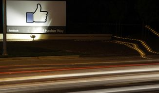 "FILE - In this June 7, 2013, file photo, the Facebook ""like"" symbol is on display on a sign outside the company's headquarters in Menlo Park, Calif. Facebook says it has purged more than 800 U.S. pages and accounts for spamming users with garbage links and clickbait. (AP Photo/Marcio Jose Sanchez, File)"