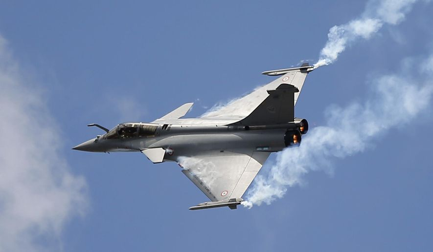 FILE - In this June 19, 2015 file photo, French Capt. Benoit Planche performs with a Rafale single seat jet aircraft during its demonstration flight at the Paris Air Show, in Le Bourget airport, north of Paris. India's defense minister is travelling Thursday Oct. 11, 2018 to Paris amid controversy over a multi-billion dollar deal in which France will sell 36 fighter jets to India. (AP Photo/Francois Mori,File)