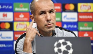 FILE - In this Oct. 2 2018 file photo, Monaco head coach Leonardo Jardim listens, during a press conference, a day ahead of the Champions League group A soccer match between Borussia Dortmund and AS Monaco in Dortmund, Germany. Monaco has fired coach Leonardo Jardim following a run of four straight losses that has left the team in the French league's relegation zone and in last place in its Champions League group. (AP Photo/Martin Meissner, File)