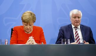 FILE - In this Sept. 21, 2018 file photo German Chancellor Angela Merkel, left, and Interior Minister Horst Seehofer, right, listen to Vice Chancellor and German Finance Minister Olaf Scholz during a joint press conference at the chancellery in Berlin, Germany. This weekend's state election in Bavaria has been casting a long shadow over German politics for the past year, and the aftershocks could cause more turbulence for Chancellor Angela Merkel's struggling national government. Polls suggest that Bavaria's center-right Christian Social Union party, which has run the southeastern region for 61 years, is heading for its worst performance since the 1950s on Sunday. (AP Photo/Markus Schreiber, file)