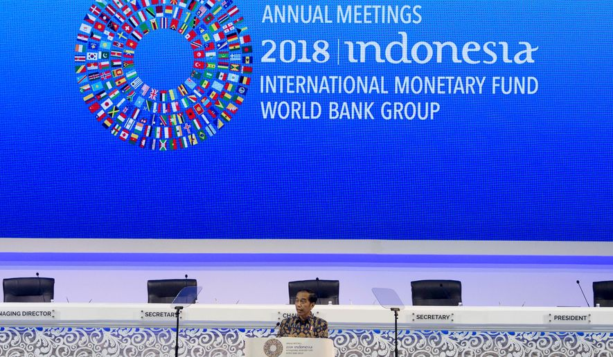 Indonesia's President Joko Widodo delivers his speech during the opening of International Monetary Fund (IMF) World Bank annual meetings in Bali, Indonesia on Friday, Oct. 12, 2018. (AP Photo/Firdia Lisnawati)