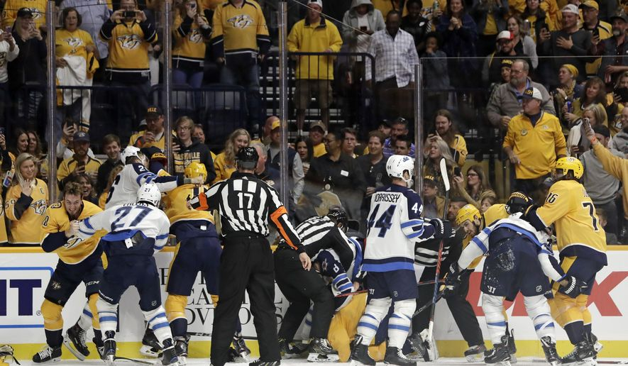 Several fights go on at once during the second period of an NHL hockey game between the Nashville Predators and the Winnipeg Jets on Thursday, Oct. 11, 2018, in Nashville, Tenn. (AP Photo/Mark Humphrey)