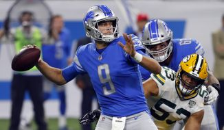 FILE - In this Sunday, Oct. 7, 2018, file photo, Detroit Lions quarterback Matthew Stafford (9) throws against the Green Bay Packers during an NFL football game in Detroit, Stafford threw four interceptions in the season opener but has only one since. (AP Photo/Paul Sancya, File)