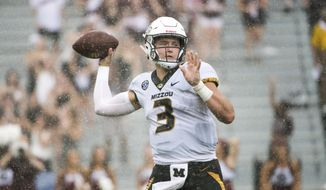 Missouri quarterback Drew Lock (3) attempts a pass against South Carolina during the second half of an NCAA college football game Saturday, Oct. 6, 2018, in Columbia, S.C. (AP Photo/Sean Rayford) ** FILE **