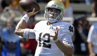 FILE - In this Sept. 22, 2018, file photo, Notre Dame's Ian Book looks to pass against Wake Forest during the first half of an NCAA college football game in Winston-Salem, N.C. Book has gone from lightly recruited to the orchestrator of a high-powered offense for the nation's No. 5-ranked team.  Notre Dame hosts Pittsburgh on Saturday. (AP Photo/Chuck Burton, File)
