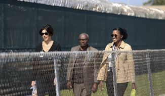 FILE - In this Nov. 15, 2017 file photo, Wilbert Jones, center,  leaves East Baton Rouge Parish Prison with Emily Maw, director of Innocence Project New Orleans, left, and Kia Hayes, IPNO staff attorney, in Baton Rouge, La. A legal ordeal that has dragged on for close to half a century is over for  Jones, a man wrongfully convicted in a 1971 rape. The advocacy group Innocence Project New Orleans said Thursday, Oct. 11, 2018, that prosecutors in Baton Rouge officially dismissed charges against Jones in the kidnapping and rape of a nurse at Baton Rouge General Hospital.  (AP Photo/Gerald Herbert, File)
