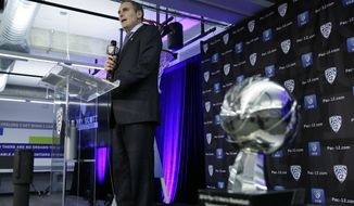 Pac-12 Commissioner Larry Scott speaks during the Pac-12 NCAA college basketball media day Thursday, Oct. 11, 2018, in San Francisco. (AP Photo/Eric Risberg)