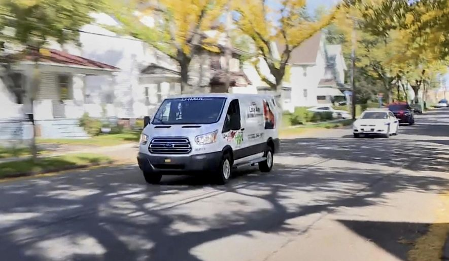 In this image taken from video provided by WHAM-TV 13, in Rochester, N.Y., police pursue a van driven by a man who fatally shot a woman with whom he had a relationship, then wounded his own son and a second man, Wednesday, Oct. 10, 2018, in Rochester. Police killed the driver in a shootout during the chase. (Will Morgan/WHAM-TV 13 via AP)