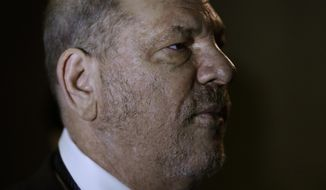 Harvey Weinstein enters State Supreme Court, Thursday, Oct. 11, 2018 in New York. Judge James Burke is expected to issue rulings Thursday on defense motions seeking to dismiss some or all of a six-count indictment accusing Weinstein of rape and sexual assault. (AP Photo/Mark Lennihan)