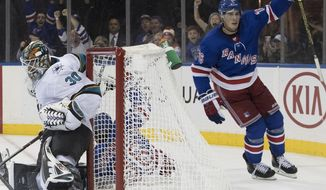 New York Rangers defenseman Brady Skjei (76) reacts after scoring past San Jose Sharks goaltender Aaron Dell (30) in overtime of an NHL hockey game Thursday, Oct. 11, 2018, at Madison Square Garden in New York. The Rangers won 3-2. (AP Photo/Mary Altaffer)