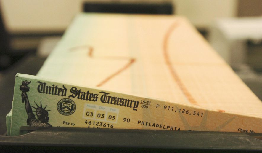 In this Feb. 11, 2005, file photo, trays of printed Social Security checks wait to be mailed from the U.S. Treasury's Financial Management services facility in Philadelphia. (AP Photo/Bradley C. Bower, File)