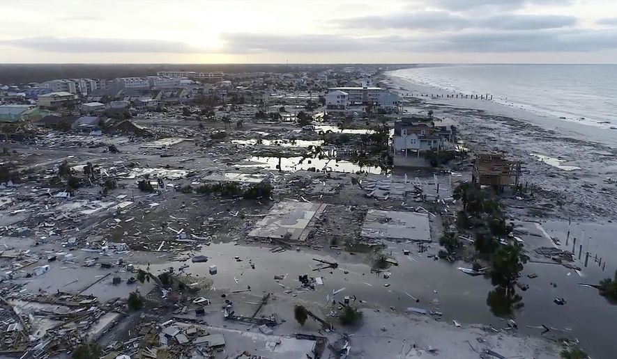 In this image made from video and provided by SevereStudios.com, damage from Hurricane Michael is seen in Mexico Beach, Fla. on Thursday, Oct. 11, 2018. Search-and-rescue teams fanned out across the Florida Panhandle to reach trapped people in Michael's wake Thursday as daylight yielded scenes of rows upon rows of houses smashed to pieces by the third-most powerful hurricane on record to hit the continental U.S. (SevereStudios.com via AP)