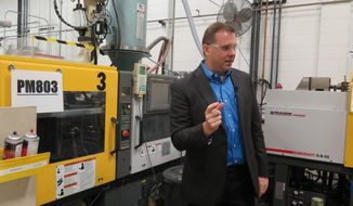 In this Wednesday, Sept. 12, 2018, photo, Paul Buzzell explains the process of making levels, at the Johnson Level and Tool plant, in Mequon, Wis. But about half the levels the company sells are imported from China and tariff increases on those products could cost the business an estimated $3.7 million annually, Buzzell said. (AP Photo/Ivan Moreno)