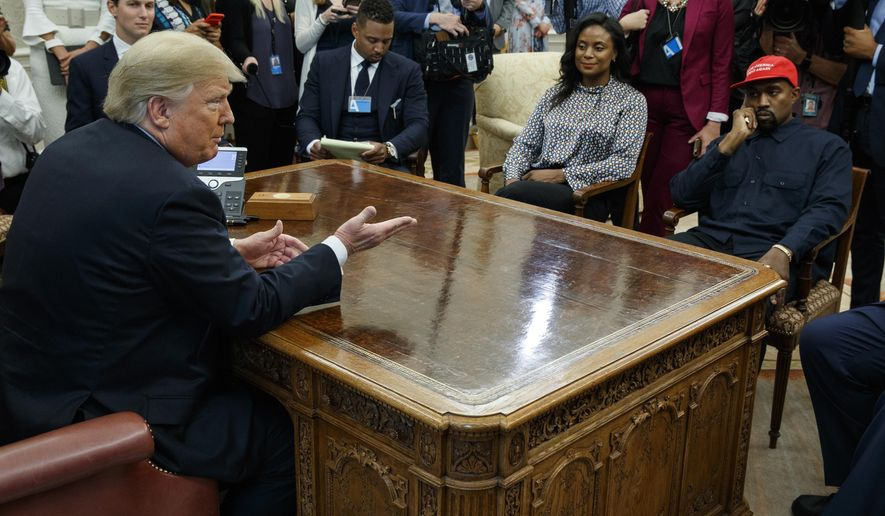 President Donald Trump meets with rapper Kanye West in the Oval Office of the White House, Thursday, Oct. 11, 2018, in Washington.  At left is White House Senior Adviser Jared Kushner. (AP Photo/Evan Vucci)
