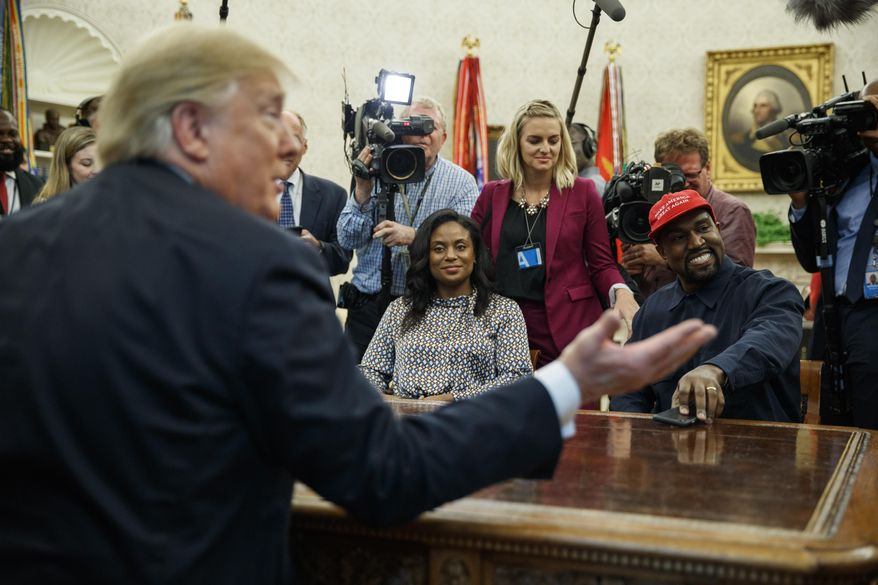 President Donald Trump meets with rapper Kanye West in the Oval Office of the White House, Thursday, Oct. 11, 2018, in Washington. (AP Photo/Evan Vucci)