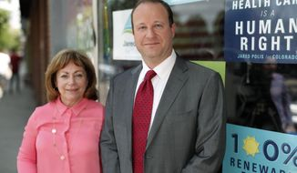 FILE - In this July 2, 2018, file photograph, Democratic nominee for Colorado's gubernatorial seat, U.S. Rep. Jared Polis, is shown with his lieutenant governor running mate, Dianne Primavera, outside their campaign headquarters in Denver. Polis is facing Republican Colorado State Treasurer Walker Stapleton for the governorship. (AP Photo/David Zalubowski, File)