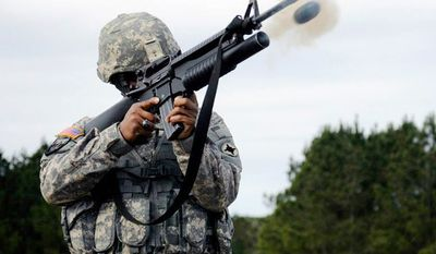 M203 Grenade Launcher - Staff Sgt. Nehemiah E. Taylor, of the Mississippi National Guard's 298th Support Battalion, fires the M203 grenade launcher during the individual weapons qualification weekend at Camp McCain, Miss.