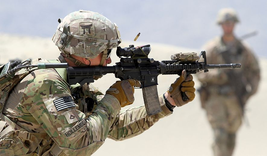 In this file photo, a 101st Airborne Division infantryman fires an M4 carbine during partnered live-fire range training May 29, 2015 in eastern Afghanistan. On Feb. 12, 2020, the Army announced it is cycling out a brigade from the storied 101st from a deployment in Africa, replacing it with a new Army unit set up specifically to train and advise foreign military units and called the 1st Security Force Assistance Brigade. (U.S. Army photo by Capt. Charlie Emmons, TAAC-E Public Affairs) **FILE**