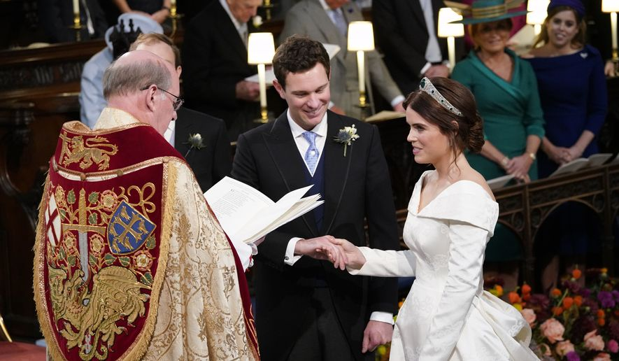 Britain's Princess Eugenie and Jack Brooksbank during their wedding ceremony in St Georges Chapel, Windsor Castle, near London, England, Friday Oct. 12, 2018. (Danny Lawson/Pool via AP)