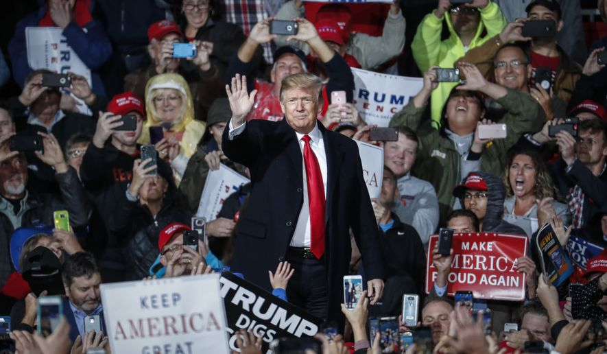 President Donald Trump waves to the crowd as he arrives to speak at a rally endorsing the Republican ticket, Friday, Oct. 12, 2018, in Lebanon, Ohio. (AP Photo/John Minchillo)
