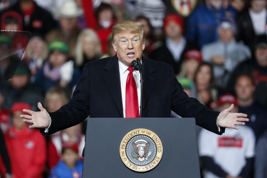 President Donald Trump speaks at a rally endorsing the Republican ticket, Friday, Oct. 12, 2018, in Lebanon, Ohio. (AP Photo/John Minchillo) **FILE**