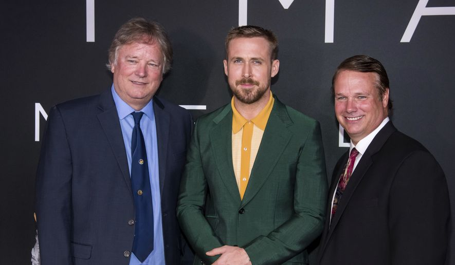 """In this Oct. 4, 2018, file photo, Rick Armstrong, left, Ryan Gosling and Mark Armstrong attend the """"First Man"""" premiere at the National Air and Space Museum of the Smithsonian Institution in Washington. Gosling says that one of the biggest challenges of making the Neil Armstrong film was knowing that his sons were going to see it. Armstrong's sons Rick and Mark Armstrong were involved in the production at every step helping to shed light on their father. (Photo by Charles Sykes/Invision/AP, File)"""
