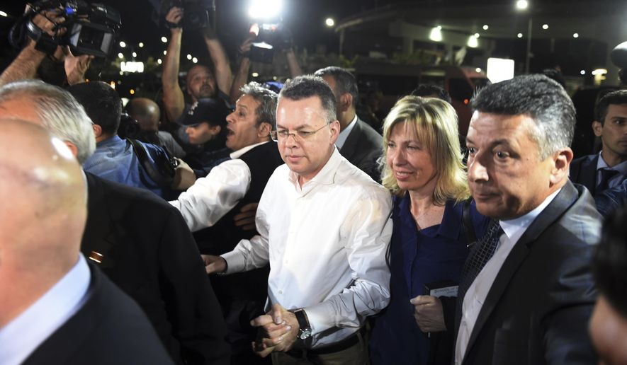 Pastor Andrew Brunson, center left, and his wife Norine Brunson arrive at Adnan Menderes airport for a flight to Germany after his release following his trial in Izmir, Turkey, Friday, Oct. 12, 2018, A Turkish court on Friday convicted an American pastor of terror charges but released him from house arrest and allowed him to leave Turkey, in a move that is likely to ease tensions between Turkey and the United. (AP Photo/Emre Tazegul)