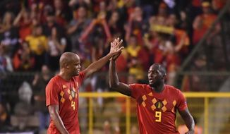 Belgium's Romelu Lukaku, right, celebrates with teammate Vincent Kompany after scoring his side's second goal during the UEFA Nations League soccer match between Belgium and Switzerland at the King Baudouin stadium in Brussels, Friday, Oct. 12, 2018. (AP Photo/Geert Vanden Wijngaert)