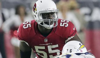 FILE - In this Aug. 11, 2018, file photo, Arizona Cardinals defensive end Chandler Jones (55) looks over the line of scrimmage during the first half of an preseason NFL football game against the Los Angeles Chargers in Glendale, Ariz. With his MMA-trained hands knocking would-be blockers out of the way, the defensive end has quietly established himself as one of the best in the game. (AP Photo/Rick Scuteri, File)