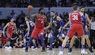 Joel Embiod of the Philadelphia 76ers, third left, controls the ball away from Salah Mejri of Dallas Mavericks, third right, during the Shenzhen basketball match between the Philadelphia 76ers and the Dallas Maverick, part of the NBA China Games, in Shenzhen city, south China's Guangdong province, Monday, Oct. 8, 2018. (AP Photo/Kin Cheung)