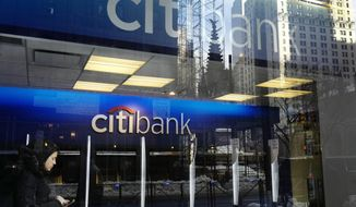 FILE - In this March 16, 2017, file photo, a customer enters a Citibank branch, in New York. Citigroup reports earnings Friday, Oct. 12, 2018. (AP Photo/Mark Lennihan, File)