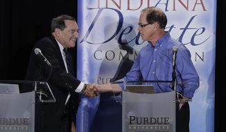 FILE - In this Oct. 8, 2018, file photo, Sen. Joe Donnelly, D-Ind., left, shakes hands with Republican former state Rep. Mike Braun following a U.S. Senate Debate in Westville, Ind. Donnelly is hoping a visit from former Vice President Joe Biden will help his effort to run up the vote in the Democratic stronghold of northwest Indiana. Vice President Mike Pence will be appearing at a fundraising dinner in Indianapolis around the same time to rev up support for Braun. (AP Photo/Darron Cummings, Pool, File)
