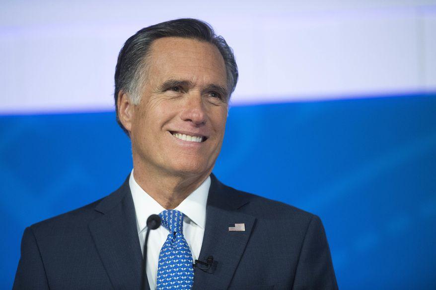 In this Oct. 9, 2018, file photo, Republican U.S. Senate candidate Mitt Romney is seen during the debate with U.S. Democratic Senate candidate Jenny Wilson in Cedar City, Utah. (James M. Dobson/The Spectrum via AP, file)