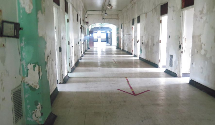 This Aug. 21, 2018 photo shows a hallway of the Trans-Allegheny Lunatic Asylum in Weston, W. Va., after visiting the nearby medical center. The 200-foot-high tower was among the many major restorations made by the Jordan family after purchasing the former Weston Hospital in 2007. It is open for daytime and nighttime ghost tours and heritage tours. (Betsy Bethel/The Intelligencer via AP)